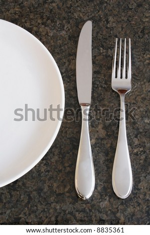 Serving Plate with Knife and Fork - stock photo