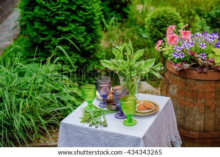 Serving table for two in the lush garden