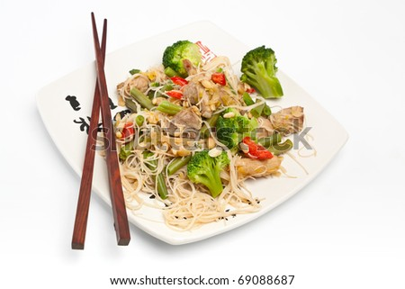 servings of warm chinese salad with cellophane noodles, meat and vegetables - stock photo