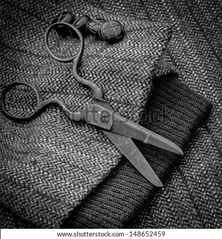 Serw.Stylish retro scissors seamstress to drape the jacket.Symbol of needlework and sewing.Instruments of repairman clothing   - stock photo