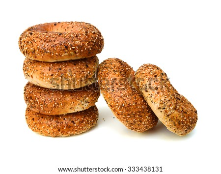 sesame bagels on white background  - stock photo