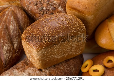 Sesame bread with different bakery products. - stock photo