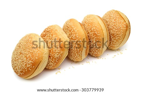 sesame buns in row on white background