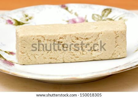 Sesame halva with vanilla flavor. - stock photo
