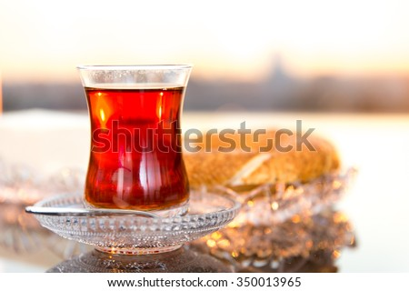 Sesame ring with butter and tea - stock photo