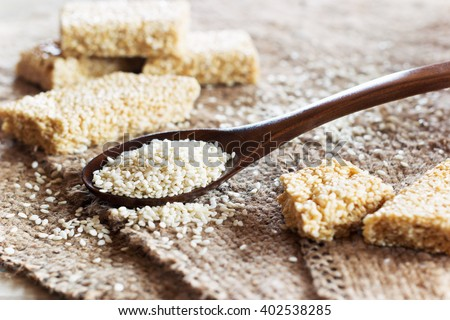 Sesame seed and sesame dessert with caramel on a linen tablecloth. Kozinak sesame seeds. Shallow DOF - stock photo