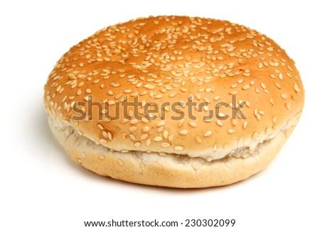 Sesame seeded hamburger bread roll. - stock photo