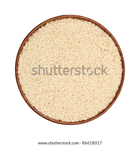 Sesame seeds in a wooden bowl, isolated, white background