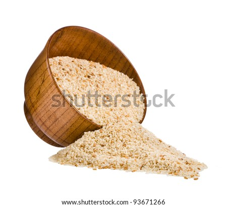 Sesame seeds in wooden bowl isolated on white background