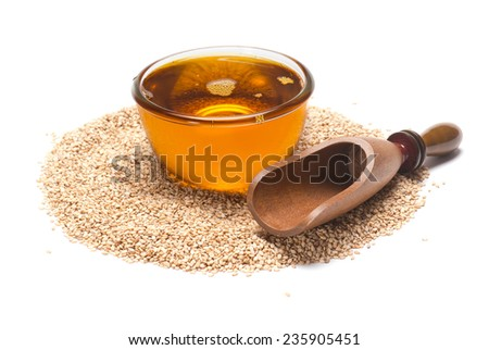 Sesame Seeds oil and scoop isolated on white background - stock photo