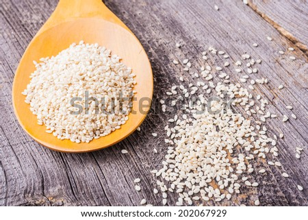 sesame seeds on a wooden table - stock photo