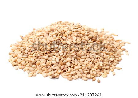 Sesame seeds on white background - stock photo
