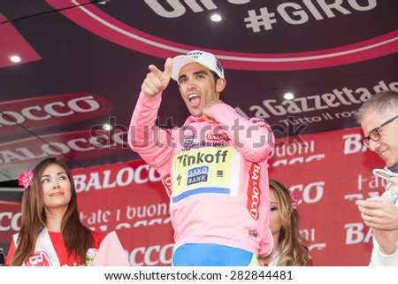 "SESTRIERE, ITALY - MAY 30, 2015: Alberto Contador, team Saxo Tinkoff, wearing pink jersey ""maglia rosa"" at the end of the 20th stage of ""Giro d'Italia"""