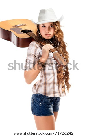 Sesy cowgirl in cowboy hat with acoustic guitar - stock photo
