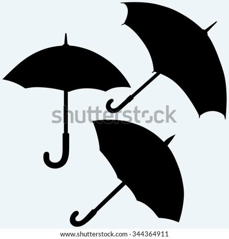Set black umbrella. Isolated on blue background. Raster silhouettes - stock photo