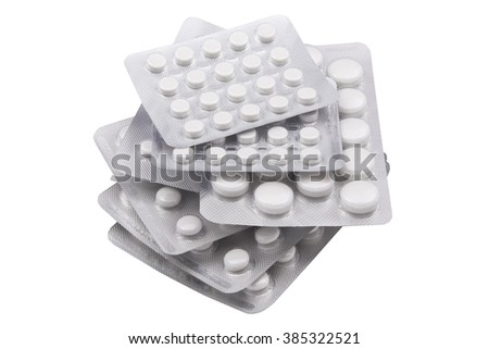 Set blisters with pills isolated on white background - stock photo