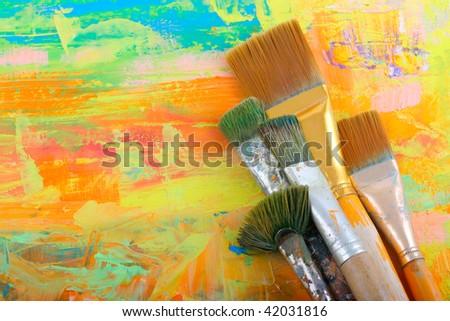 Set brushes on painted background. - stock photo