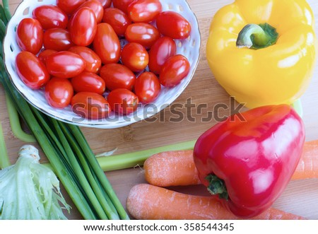 set eco farm vegetables on kitchen table - stock photo