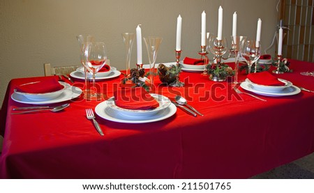 Set empty table at Christmas, indoors