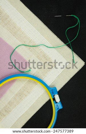Set for cross stitch. Canvas. Sewing hoop. Needle. - stock photo