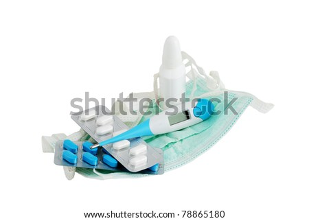 Set for flu treatment included thermometer, two types of pills, nasal spray and procedure mask isolated on white background - stock photo