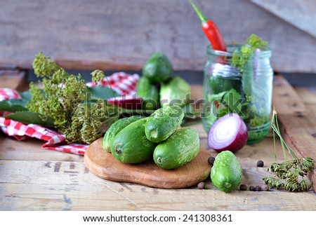 Set for home canning cucumbers on a background of onion, dill, parsley, red pepper.Selective focus - stock photo