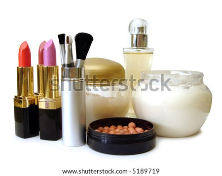 set for make-up (cream, brushes, perfume and lipsticks) - stock photo