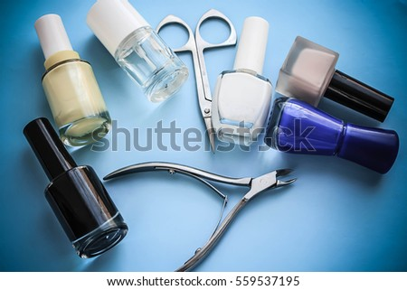 Set for manicure on a blue background. Tools for female beauty hands