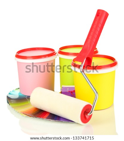 Set for painting: paint pots, brushes, paint-roller, palette of colors isolated on white - stock photo