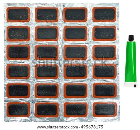 Set for repair of bicycle, inner and other rubber bags on an aluminum metal foil. A set of patches in a leak-proof package, glue for rubber. Isolated on white background. Middle size.