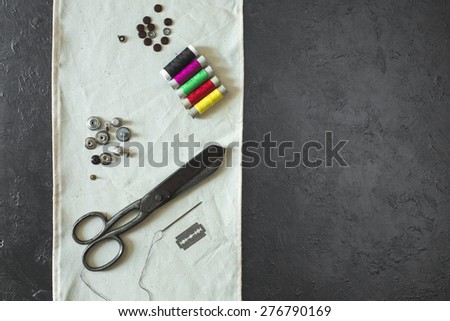 Set for sewing: scissors needle ,thread on black background - stock photo