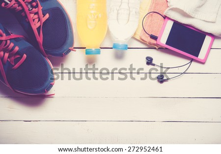Set for sports activities on white wooden background,vintage color toned image - stock photo