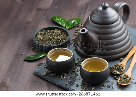 set for tea ceremony on a wooden table, horizontal - stock photo