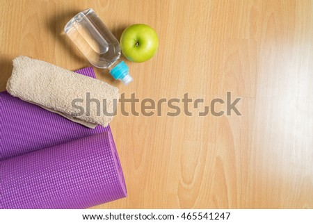 Set For Yoga Practice With Purple Mat Towel Bottle Of Water And Green Apple View Preview