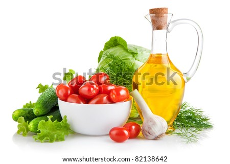 set fresh vegetables with olive oil isolated on white background - stock photo