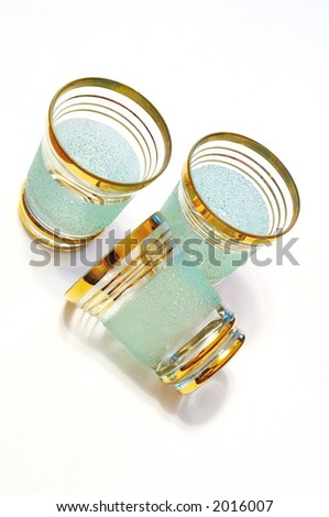 Set from three liqueur glasses. - stock photo
