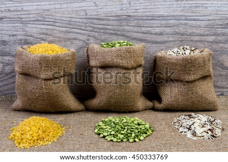 Set groats, peas, rice, millet, peas in sacks, burlap - stock photo