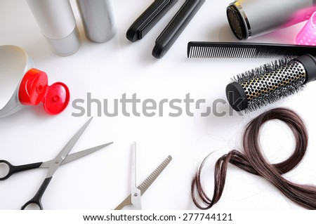 Set hairdressing articles exposed on a white table with room in the center for writing top view isolated - stock photo