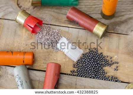 set hunting shotgun cartridges on a wooden table  - stock photo