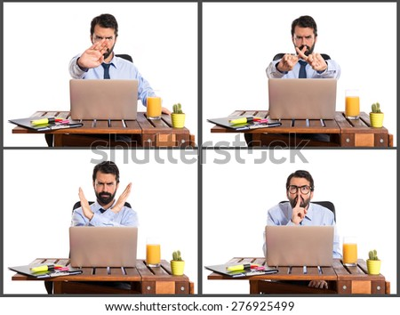 Set images of businessman in his office making silence gesture and stop sign - stock photo