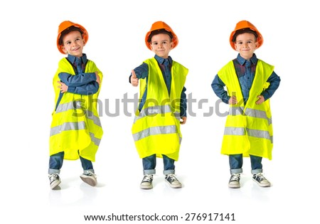 Set images of child dressed as a workman - stock photo