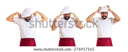 Set images of frustrated chef over white background - stock photo