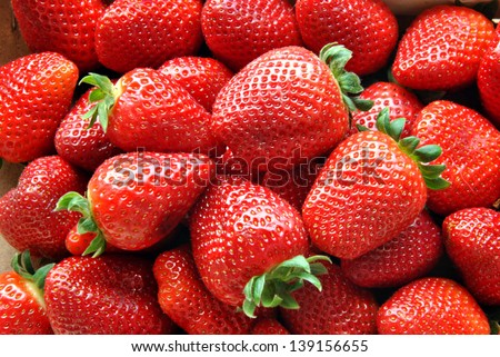 set in a box of strawberries before eating - stock photo