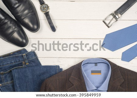 set  men's clothing, shoes  and accessories  on wooden background. Men accessories. Black elegant accessories pieces isolated on white wooden table. Top view. - stock photo