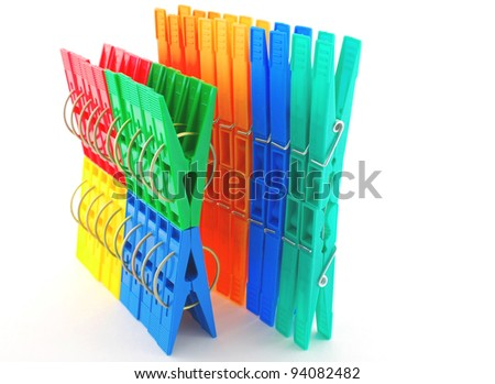 Set multi color clothes-pegs over white