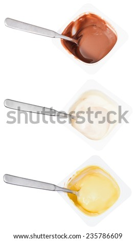 set of above view of yogurt and spoon in disposable plastic cups isolated on white background - stock photo