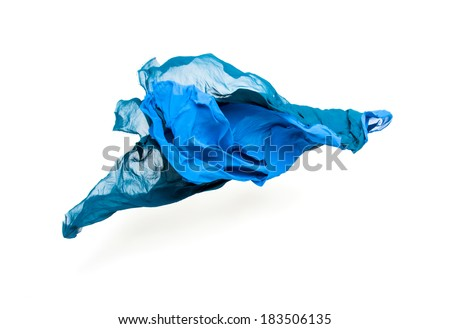 set of abstract pieces of blue fabric flying, high-speed studio shot - stock photo