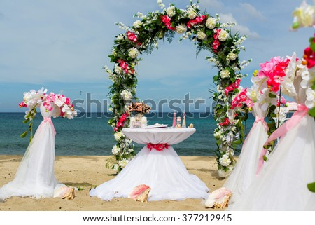 set of accessories for a wedding on the shores of the Caribbean Sea. Arch decorated with flowers