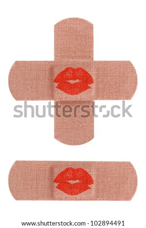 Set of adhesive medical bandages or bandaids with red kisses isolated on white background. - stock photo