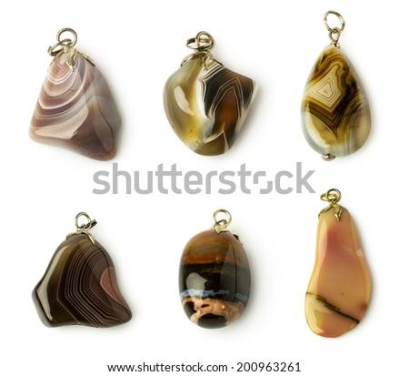 set of agate pendants isolated on white - stock photo